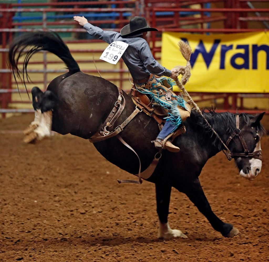 Tanner Lockhart (199) competes in the saddle bronc riding competition during the ABC Pro Rodeo, Thursday, March 29, 2018, at Municipal Coliseum in Lubbock, Texas. [Brad Tollefson/A-J Media]