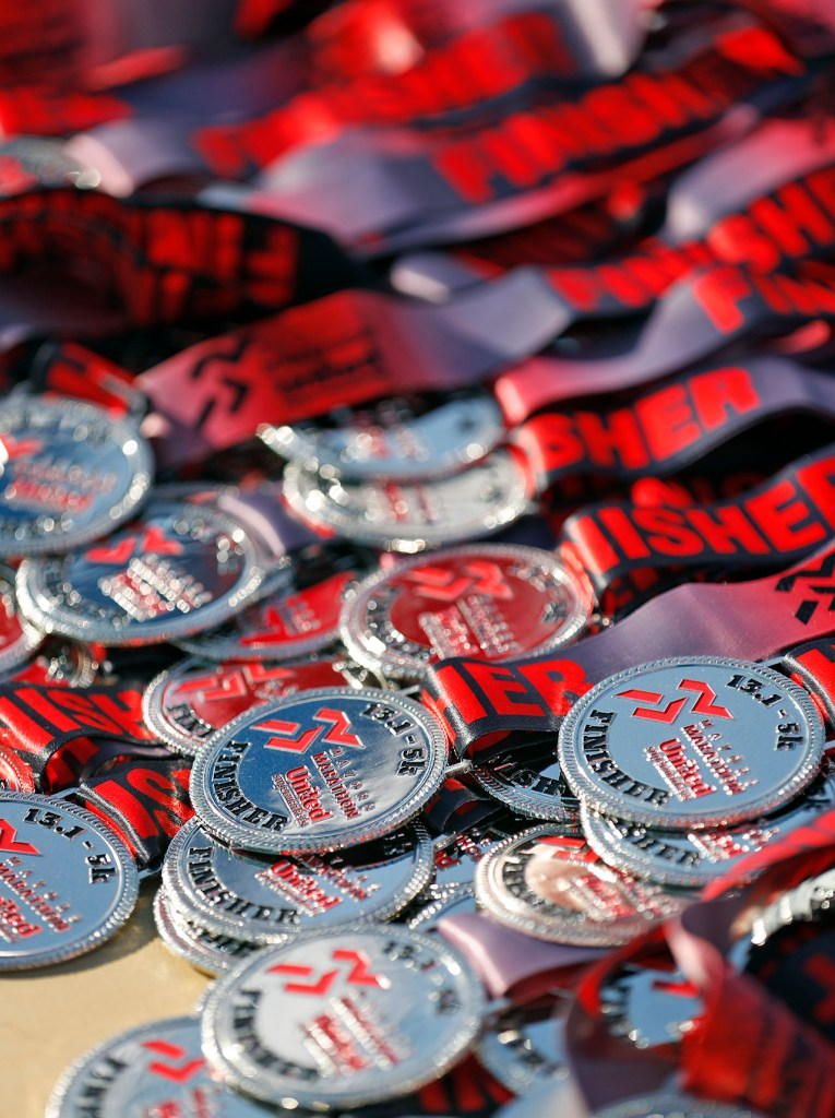 Medals for the 5K and half marathon finishers during the Mayor's Marathon, Sunday, April 22, 2018, in Lubbock, Texas. [Brad Tollefson/A-J Media]