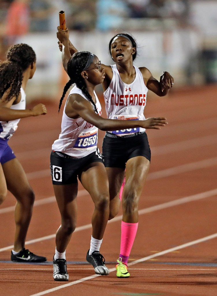Coronado's Raven Woodson hands the baton to Diamond Lilly in the 4x400 meter race during the UIL State Track and Field meet, Friday, May 11, 2018, at Mike A. Myers Stadium in Austin, Texas. [Brad Tollefson/A-J Media]