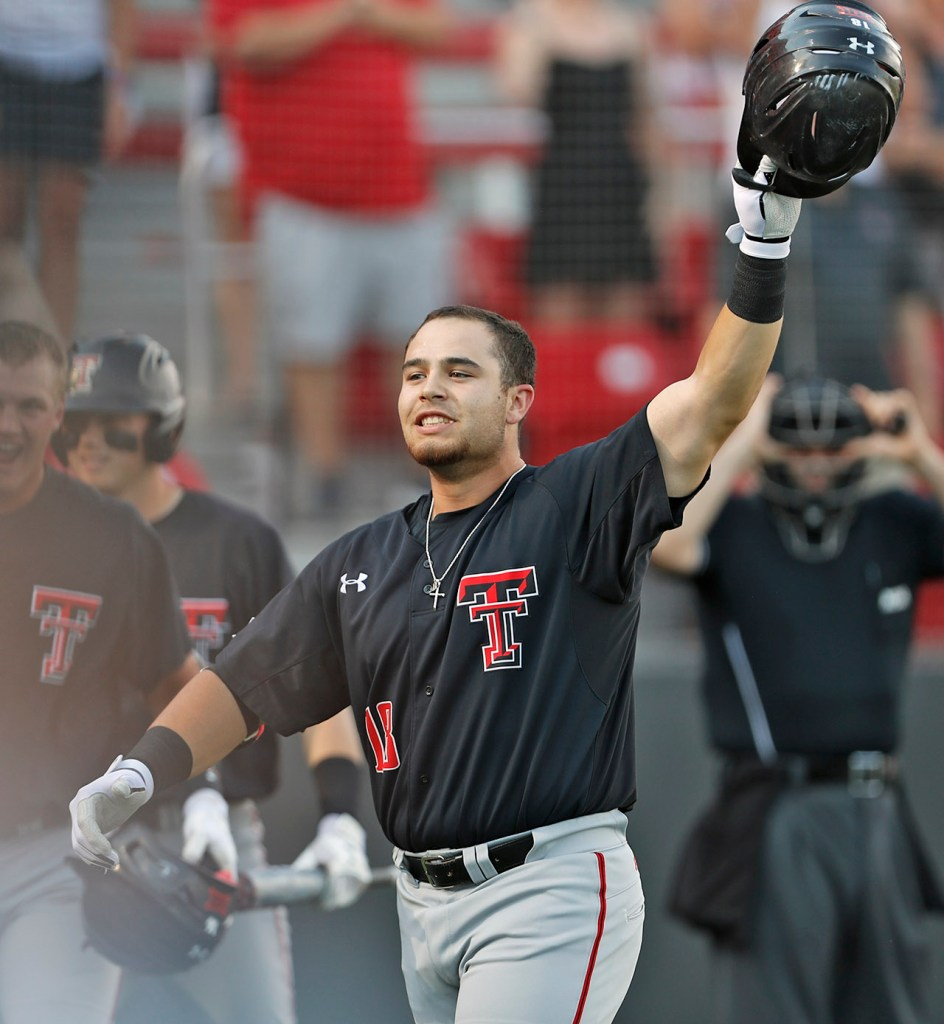 Texas Tech's Zach Rheams (18) holds up his helmet after hitting a home run during an NCAA college baseball tournament regional game against Louisville, Sunday, June 3, 2018, in Lubbock, Texas. [Brad Tollefson/A-J Media]