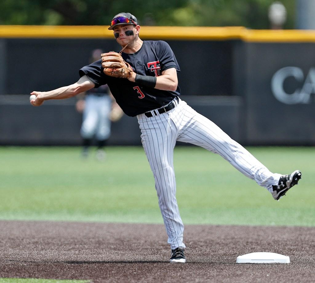 Texas Tech's Michael Davis (3) throws the ball to first base during an NCAA college baseball tournament super regional game against Duke, Saturday, June 9, 2018, in Lubbock, Texas. [Brad Tollefson/A-J Media]