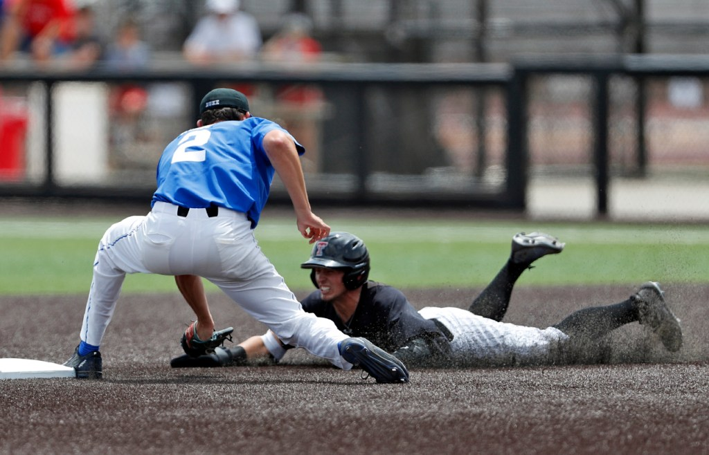 Duke's Zack Kone (2) tags out Texas Tech's Gabe Holt (2) as he slides into second base during an NCAA college baseball tournament super regional game Saturday, June 9, 2018, in Lubbock, Texas. [Brad Tollefson/A-J Media]
