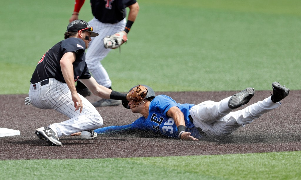Texas Tech's Michael Davis (3) tags out Duke's Joey Loperfido (36) as he slides into second base during an NCAA college baseball tournament super regional game Saturday, June 9, 2018, in Lubbock, Texas. [Brad Tollefson/A-J Media]