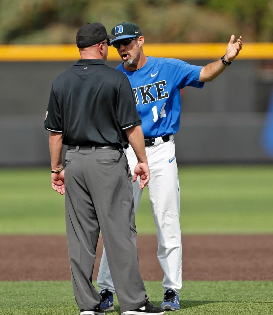 Duke coach Chris Pollard argues a call with second base umpire Scott Cline during an NCAA college baseball tournament super regional game against Texas Tech, Saturday, June 9, 2018, in Lubbock, Texas. [Brad Tollefson/A-J Media]