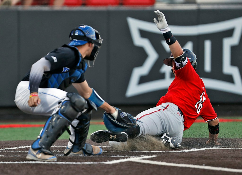 Duke's Chris Proctor (23) tags out Texas Tech's Josh Jung (16) as he slides into home plate during an NCAA college baseball tournament super regional game Sunday, June 10, 2018, in Lubbock, Texas. [Brad Tollefson/A-J Media]