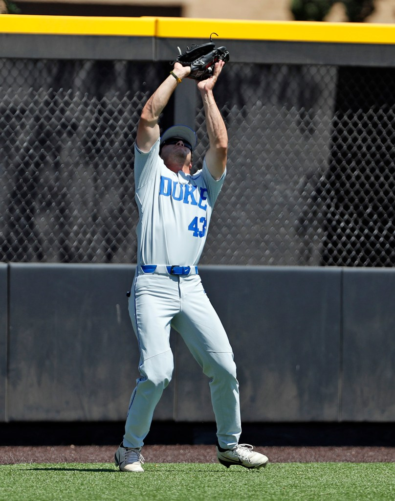 Duke's Chase Cheek (43) catches a fly ball during an NCAA college baseball tournament super regional game against Texas Tech, Monday, June 11, 2018, in Lubbock, Texas. [Brad Tollefson/A-J Media]