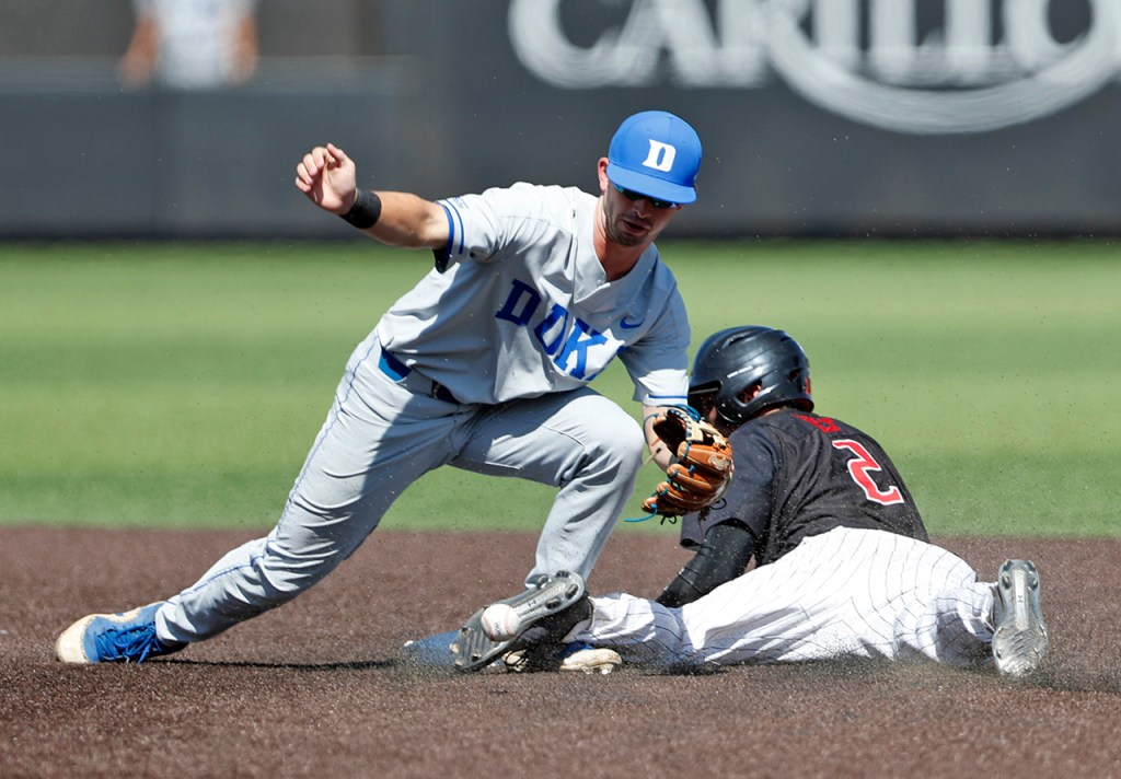 Texas Tech's Gabe Holt (2) slides into second base past Duke's Max Miller (5) during an NCAA college baseball tournament super regional game Monday, June 11, 2018, in Lubbock, Texas. [Brad Tollefson/A-J Media]