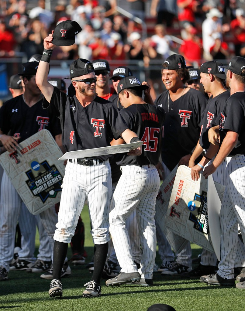 Texas Tech players celebrate after an NCAA college baseball tournament super regional game against Duke, Monday, June 11, 2018, in Lubbock, Texas. [Brad Tollefson/A-J Media]