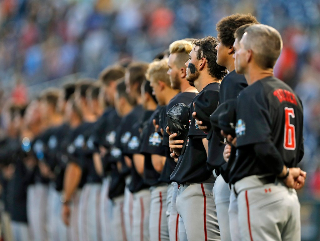 Texas Tech players stand for the national anthem during a College World Series baseball game against Florida, Sunday, June 17, 2018, at TD Ameritrade Park in Omaha, Neb. [Brad Tollefson/A-J Media]
