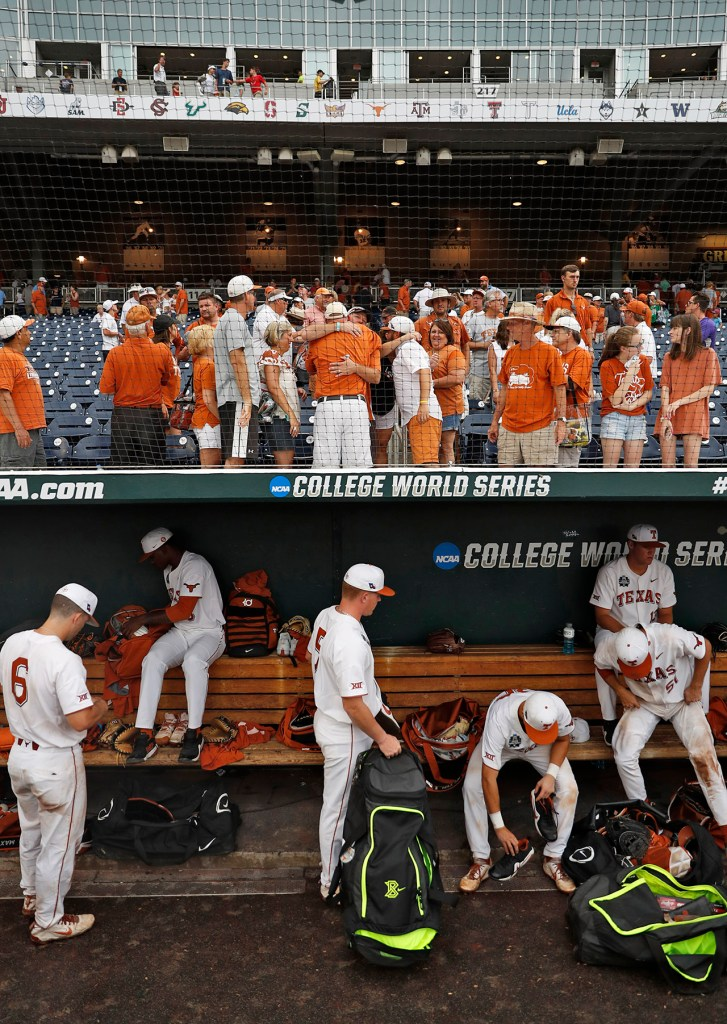Texas players and fans leave the stands after a College World Series baseball game against Florida, Tuesday, June 19, 2018, at TD Ameritrade Park in Omaha, Neb. [Brad Tollefson/A-J Media]