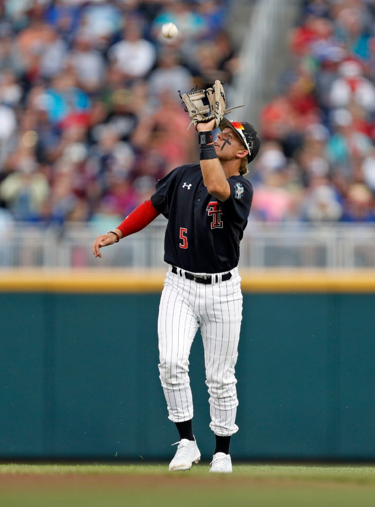 Texas Tech's Brian Klein (5) catches a fly ball during a College World Series baseball game against Florida, Thursday, June 21, 2018, at TD Ameritrade Park in Omaha, Neb. [Brad Tollefson/A-J Media]