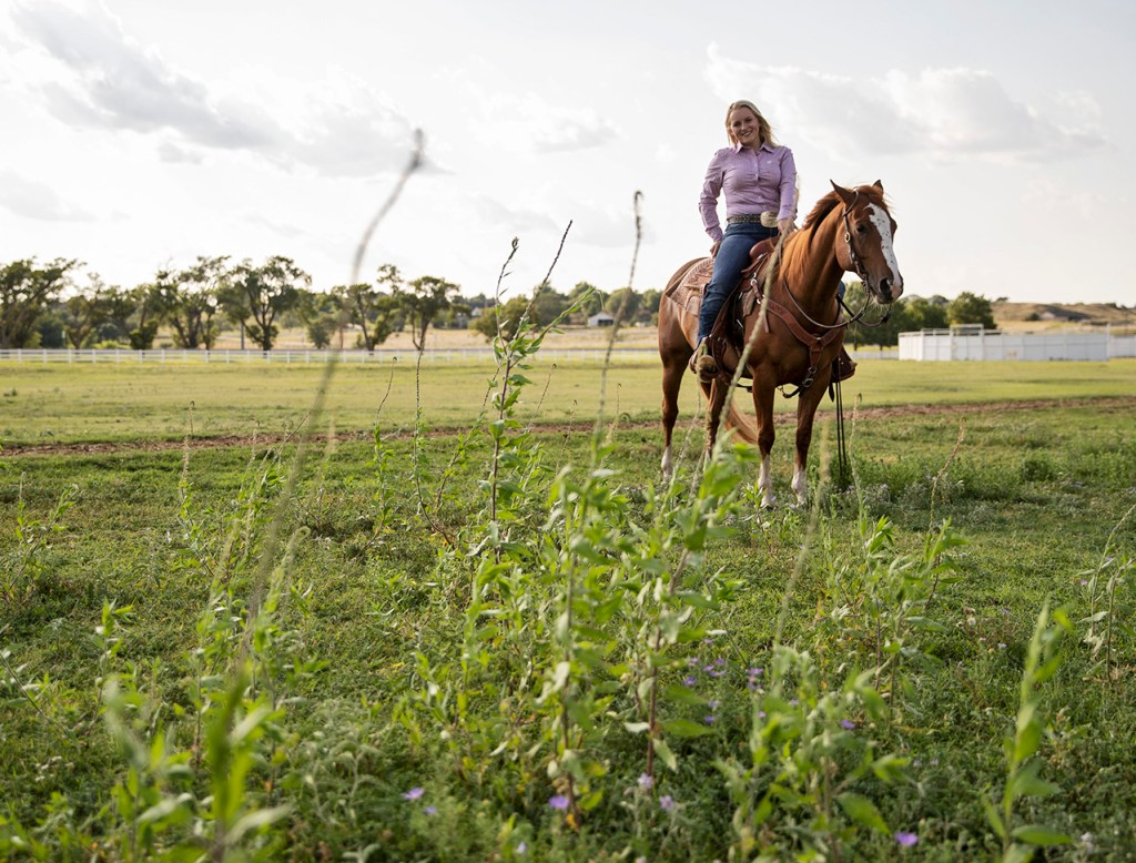 Lacey Edge rides her horse Buddy through the pasture Saturday, Aug. 4, 2018, at West Texas A&M Horse Center in Canyon, Texas. Edge has gelded more than 100 stallions with her mom since 2010 as part of Operation Gelding. (Brad Tollefson/Out Here Magazine)