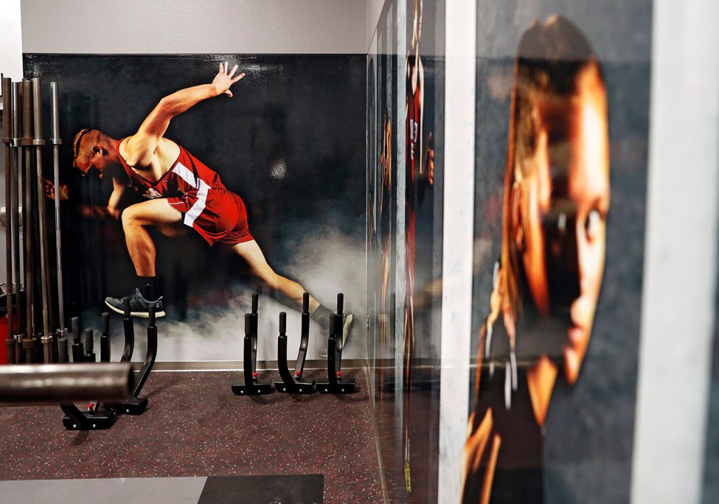 Images and graphics printed on the walls of the weight room and locker rooms, Thursday, Jan. 24, 2019, at Bulldog Stadium in Borger, Texas. (Brad Tollefson)