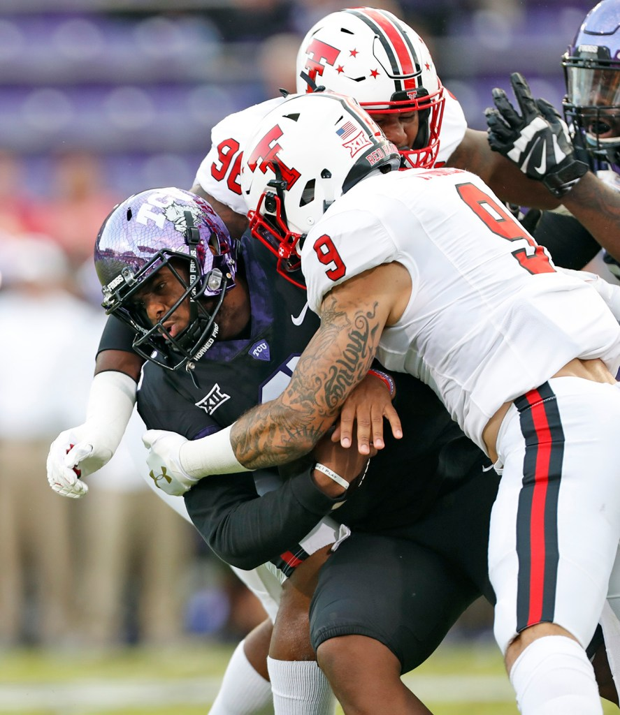 TCU's Shawn Robinson (3) is tackled by Texas Tech's Tony Jones (9) during the first half of an NCAA college football game Thursday, Oct. 11, 2018, at Amon G. Carter Stadium in Fort Worth, Texas. [Brad Tollefson/A-J Media]