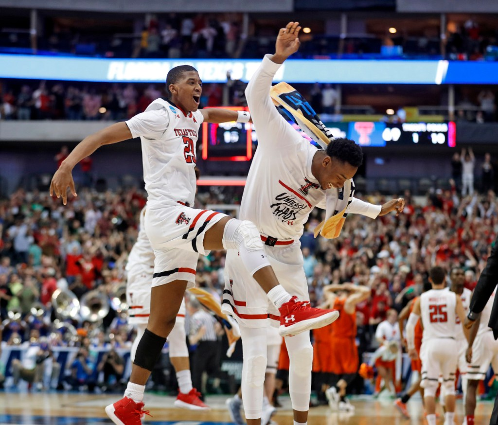 Texas Tech's Jarrett Culver (23) and Malik Ondigo (21) celebrate after an NCAA college basketball tournament second-round game against Florida, Saturday, March 17, 2018, at American Airlines Center in Dallas, Texas. [Brad Tollefson/A-J Media]