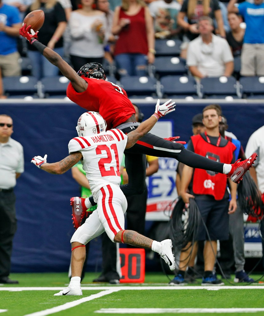 Texas Tech's T.J. Vasher (9) catches the pass over Mississippi's Javien Hamilton (21) during the season opener, Saturday, Sept. 1, 2018, at NRG Stadium in Houston, Texas. [Brad Tollefson/A-J Media]