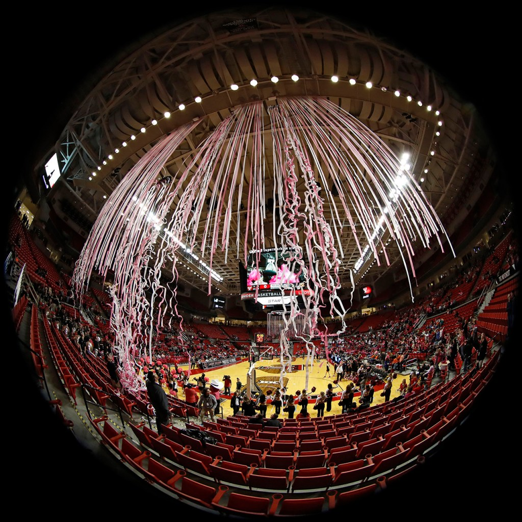 Pink and white streamers fall from the rafters before the Play4Kay game between Texas Tech and Oklahoma State, Saturday, Feb. 9, 2019, at United Supermarkets Arena in Lubbock, Texas. [Brad Tollefson/A-J Media]