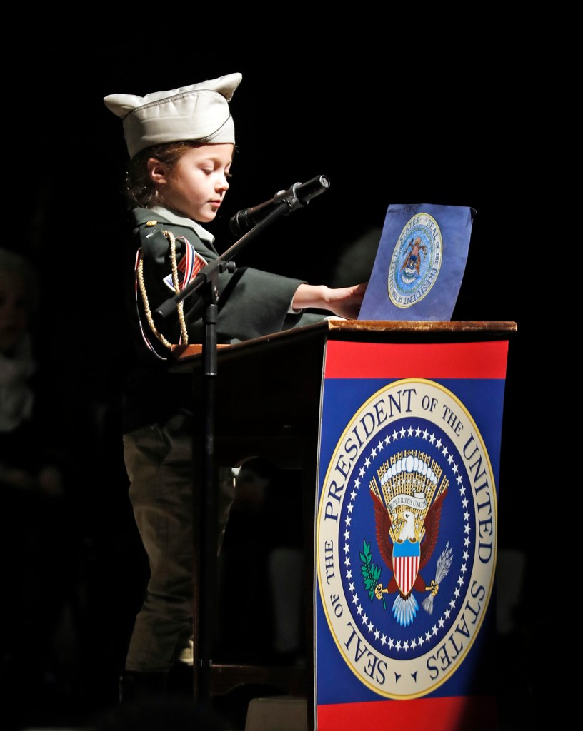 Leighton Lewis, dressed as Dwight Eisenhower, talks about his time as the president during the All Saints second grade Hall of Presidents presentation Thursday, Feb. 21, 2019, at All Saints Episcopal School in Lubbock, Texas. [Brad Tollefson/A-J Media]