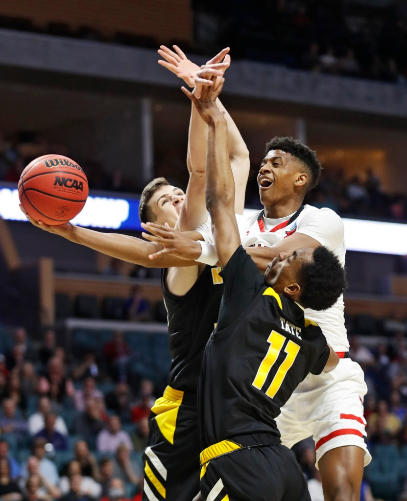 Texas Tech's Jarrett Culver (23) shoots the ball around around Northern Kentucky's and Chris Vogt (33) Northern Kentucky's Jalen Tate (11) during the NCAA tournament first round game Friday, March 22, 2019, at BOK Center in Tulsa, Okla. [Brad Tollefson/A-J Media]