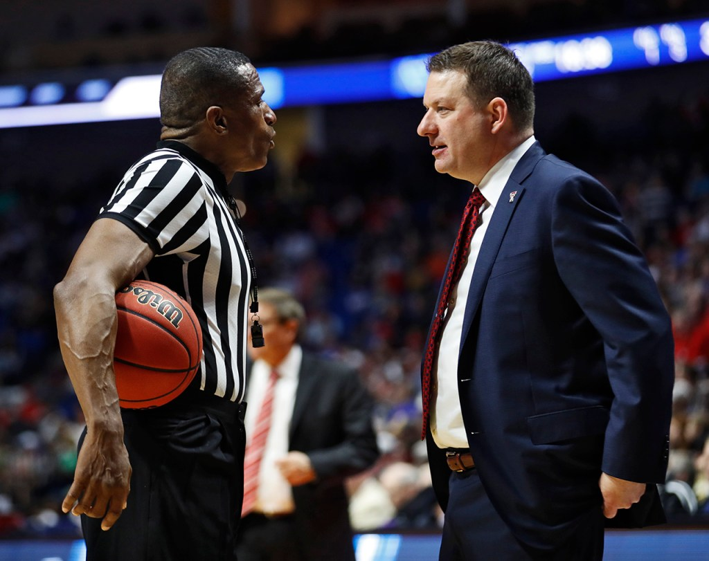 Texas Tech coach Chris Beard talks to referee Ted Valentine during the NCAA tournament second round game against Buffalo, Sunday, March 24, 2019, at BOK Center in Tulsa, Okla. [Brad Tollefson/A-J Media]