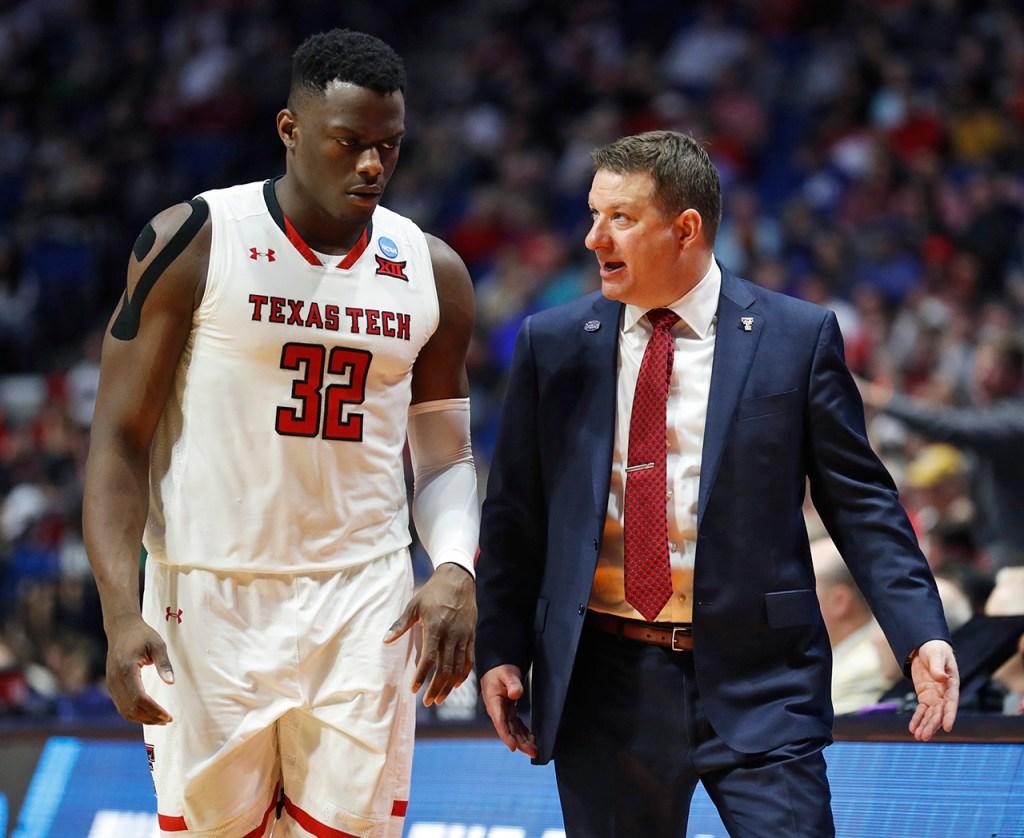 Texas Tech coach Chris Beard talks to Norense Odiase (32) during the NCAA tournament second round game against Buffalo, Sunday, March 24, 2019, at BOK Center in Tulsa, Okla. [Brad Tollefson/A-J Media]