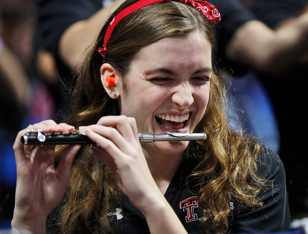 Amy McPherson, from Austin, laughs while playing the piccolo with the Goin' Band during the NCAA tournament second round game against Buffalo, Sunday, March 24, 2019, at BOK Center in Tulsa, Okla. [Brad Tollefson/A-J Media]