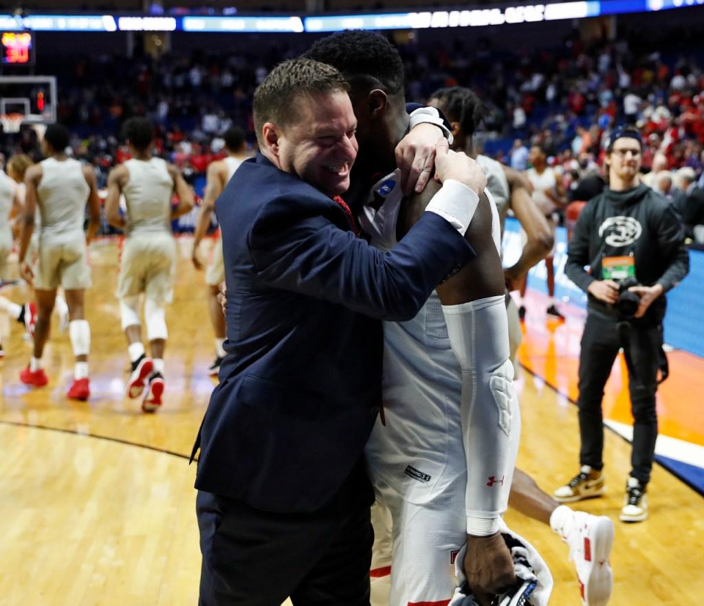 Texas Tech coach Chris Beard hugs Norense Odiase (32) after the NCAA tournament second round game against Buffalo, Sunday, March 24, 2019, at BOK Center in Tulsa, Okla. [Brad Tollefson/A-J Media]