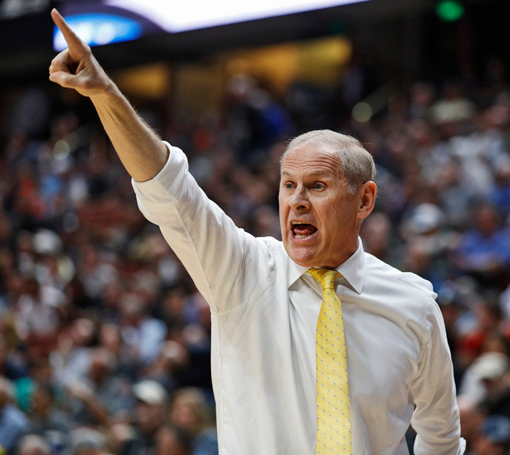 Michigan coach John Beilein yells out to his players during the NCAA tournament Sweet 16 game against Texas Tech, Thursday, March 28, 2019, at Honda Center in Anaheim, Calif. [Brad Tollefson/A-J Media]