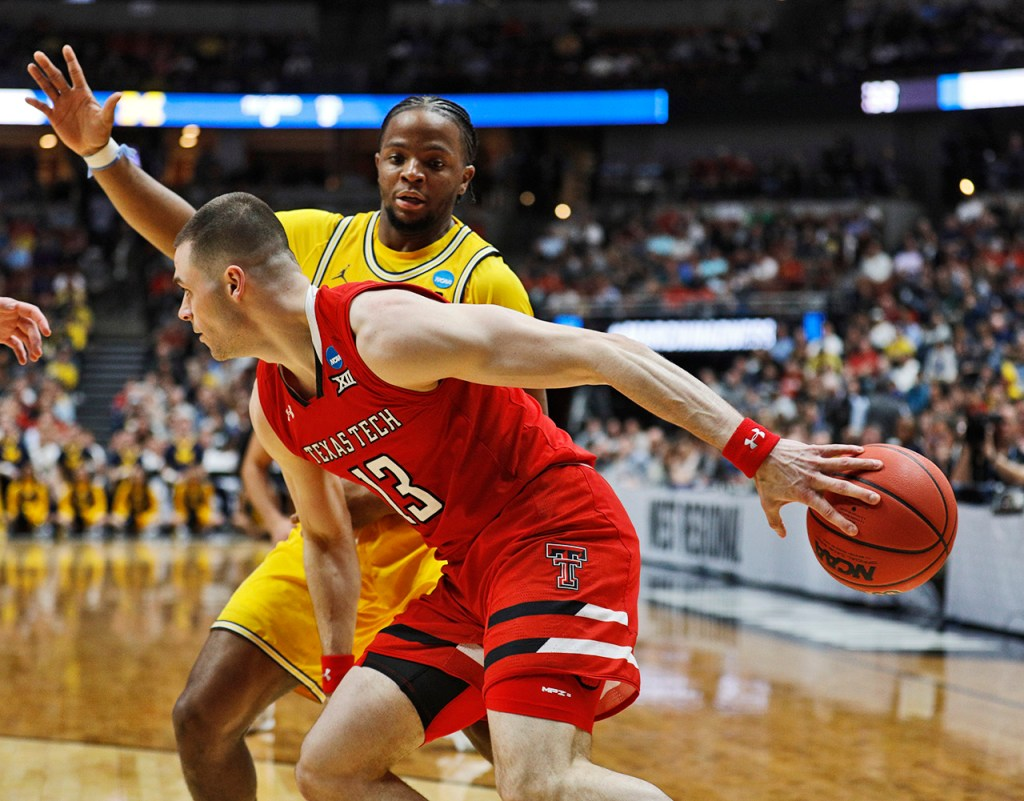 Texas Tech's Matt Mooney (13) passes the ball around his back and Michigan's Zavier Simpson (3) during the NCAA tournament Sweet 16 game Thursday, March 28, 2019, at Honda Center in Anaheim, Calif. [Brad Tollefson/A-J Media]