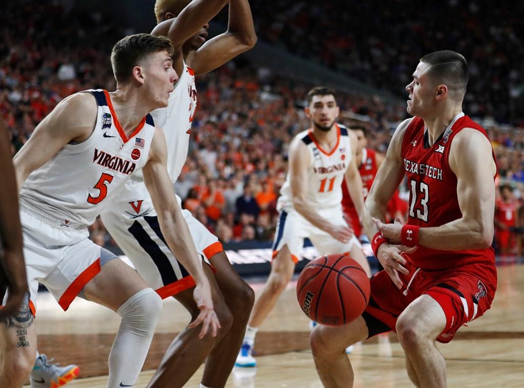 Virginia's Kyle Guy (5) knocks the ball away from Texas Tech's Matt Mooney (13) during the men's basketball national championship against Virginia, Monday, April 8, 2019, at U.S. Bank Stadium in Minneapolis, Minn. [Brad Tollefson/A-J Media]