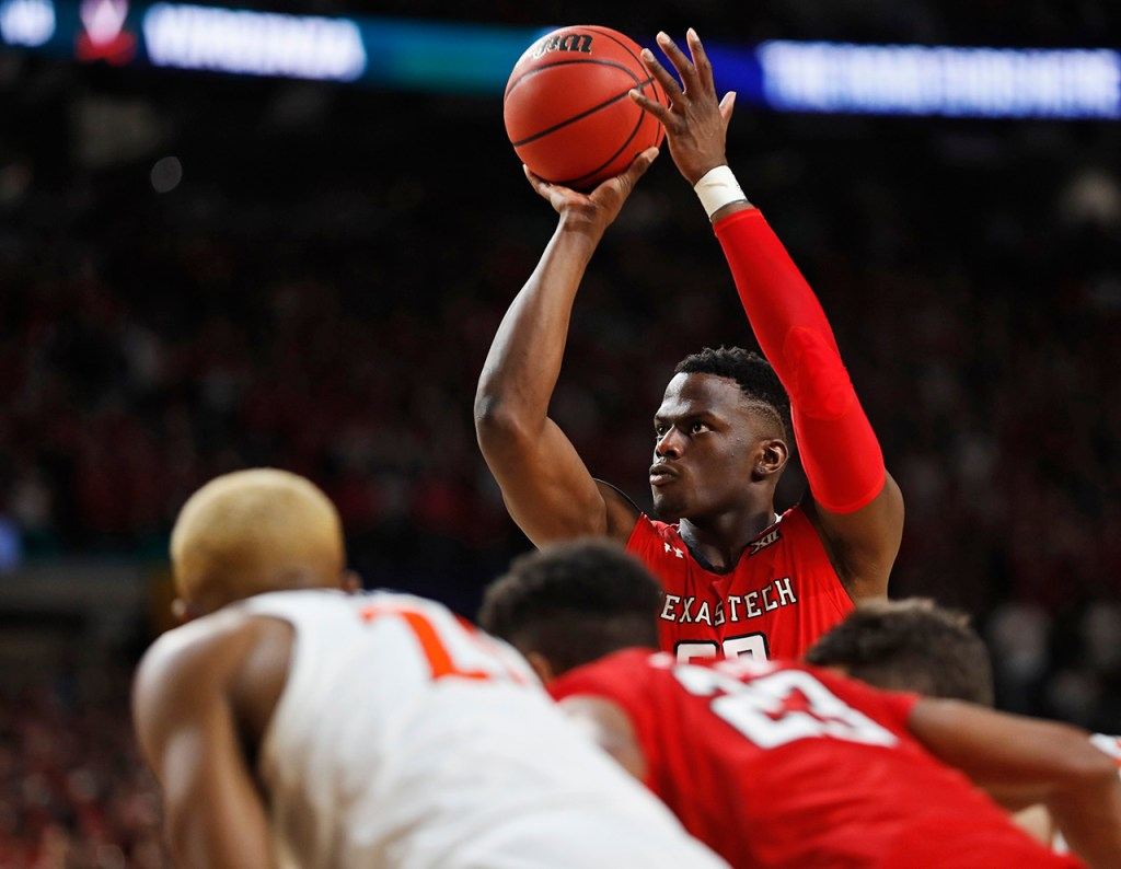 Texas Tech's Norense Odiase (32) shoots a free throw during the men's basketball national championship against Virginia, Monday, April 8, 2019, at U.S. Bank Stadium in Minneapolis, Minn. [Brad Tollefson/A-J Media]