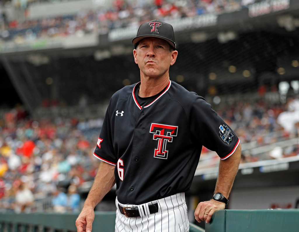 Texas Tech coach Tim Tadlock walks up as his name is announced before the College World Series game against Michigan, Saturday, June 15, 2019, at TD Ameritrade Park in Omaha, Neb. [Brad Tollefson/A-J Media]