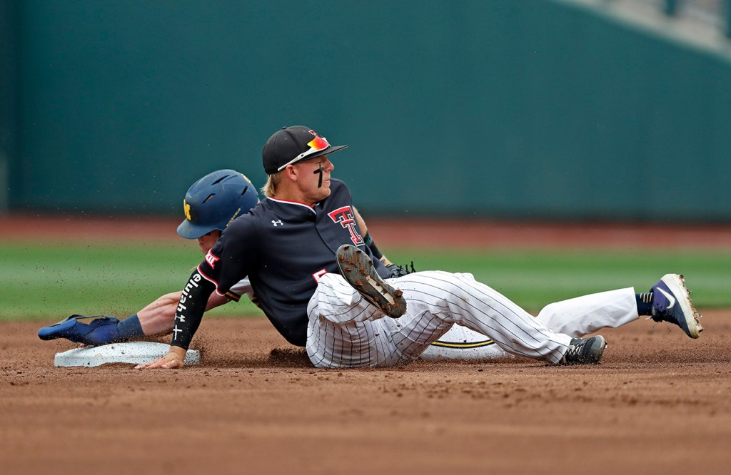 Michigan's Jack Blomgren (2) slides into second base around Texas Tech's Brian Klein (5) during the College World Series game Saturday, June 15, 2019, at TD Ameritrade Park in Omaha, Neb. [Brad Tollefson/A-J Media]