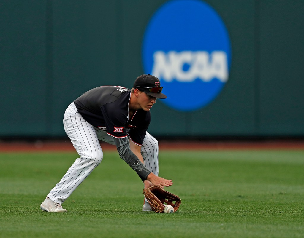 Texas Tech's Kurt Wilson (8) fields a ground ball during the College World Series game against Michigan, Saturday, June 15, 2019, at TD Ameritrade Park in Omaha, Neb. [Brad Tollefson/A-J Media]