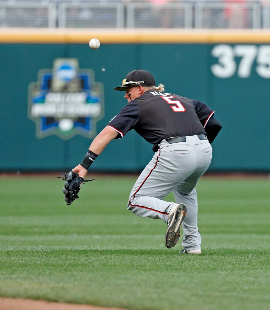 Texas Tech's Brian Klein (5) tries to catch the ball after it bounces off his glove during the College World Series game against Florida State, Wednesday, June 19, 2019, at TD Ameritrade Park in Omaha, Neb. [Brad Tollefson/A-J Media]