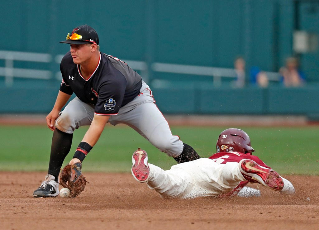 Florida State's Mike Salvatore (16) slides into second base past Texas Tech's Josh Jung (16) during the College World Series game Wednesday, June 19, 2019, at TD Ameritrade Park in Omaha, Neb. [Brad Tollefson/A-J Media]
