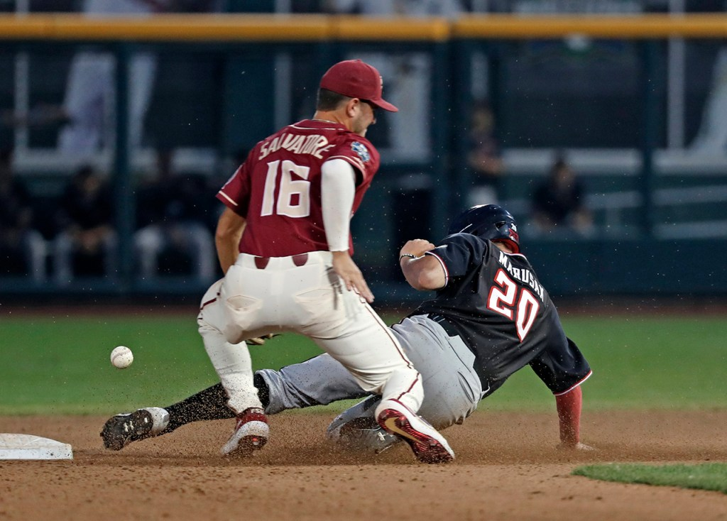 Texas Tech's Max Marusak (20) slides into second base around Florida State's Mike Salvatore (16) during the College World Series game Wednesday, June 19, 2019, at TD Ameritrade Park in Omaha, Neb. [Brad Tollefson/A-J Media]