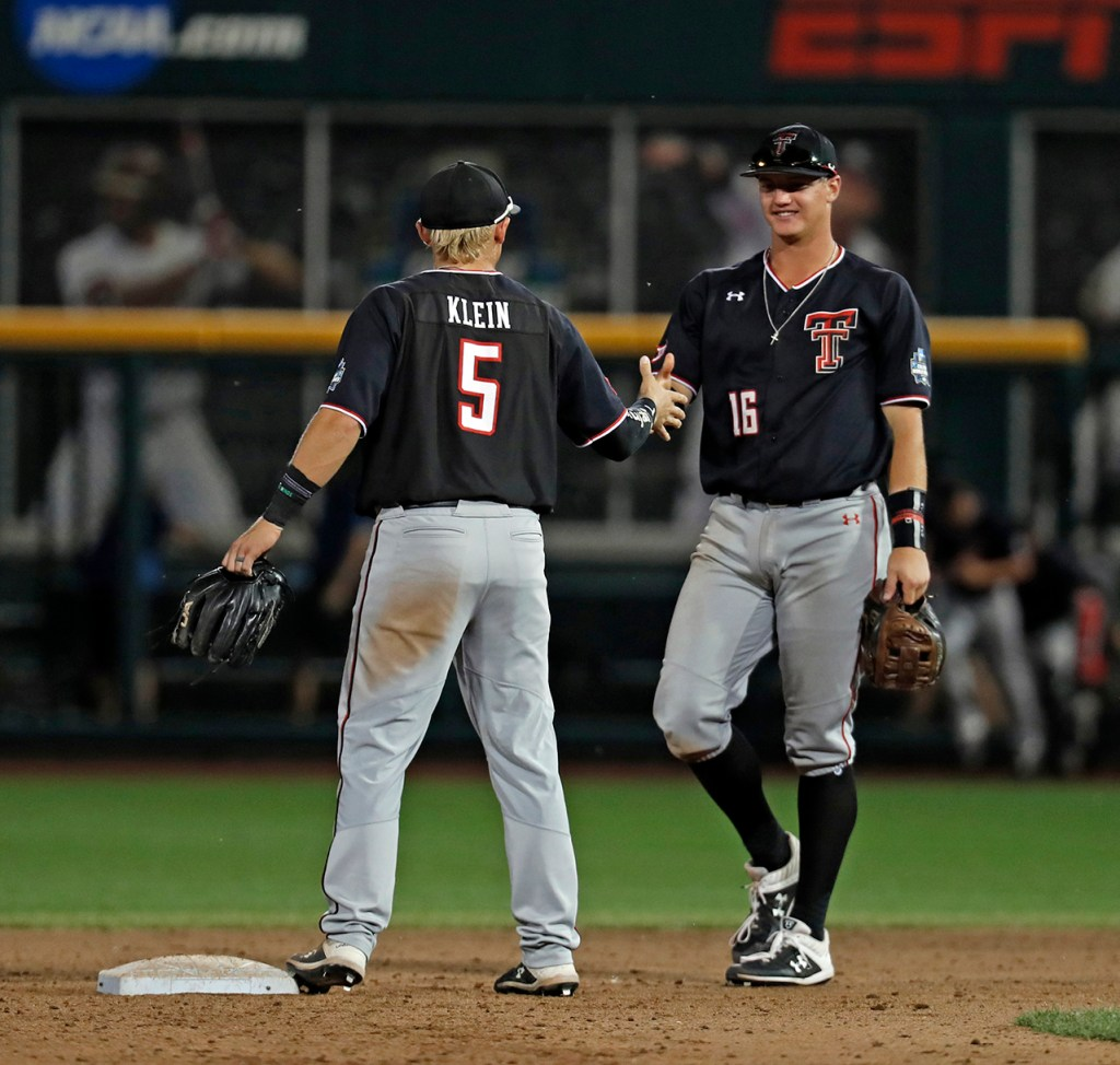 Texas Tech's Brian Klein (5) and Josh Jung (16) celebrate after the College World Series game against Florida State, Wednesday, June 19, 2019, at TD Ameritrade Park in Omaha, Neb. [Brad Tollefson/A-J Media]