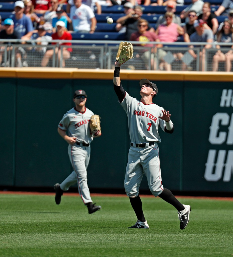 Texas Tech's Cody Masters (7) catches a fly ball during the College World Series game against Michigan, Friday, June 21, 2019, at TD Ameritrade Park in Omaha, Neb. [Brad Tollefson/A-J Media]