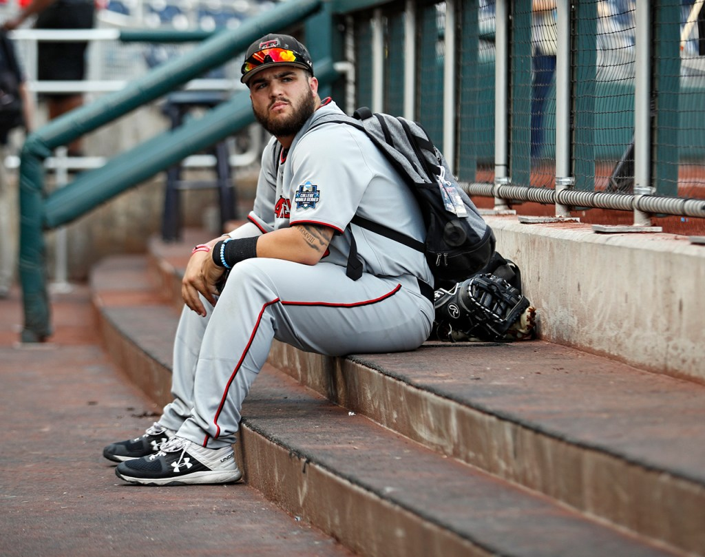 Texas Tech's Doug Facendo (36) sits in the dugout after the College World Series game against Michigan, Friday, June 21, 2019, at TD Ameritrade Park in Omaha, Neb. [Brad Tollefson/A-J Media]