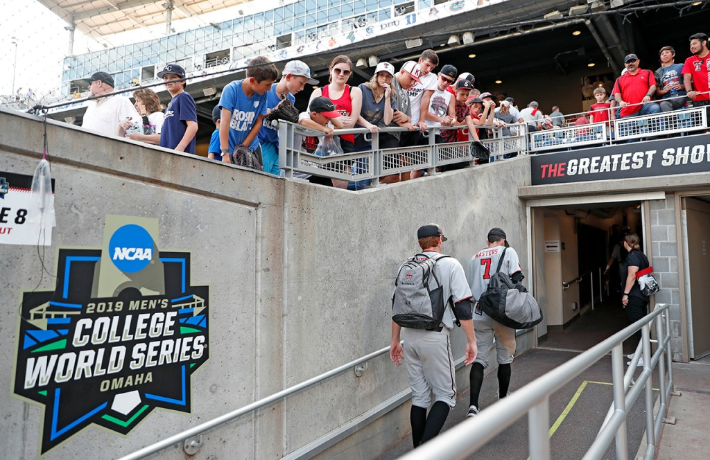 Texas Tech's Hunter Dobbins (42) and Cody Masters (7) walk out of the dugout after the College World Series game against Michigan, Friday, June 21, 2019, at TD Ameritrade Park in Omaha, Neb. [Brad Tollefson/A-J Media]