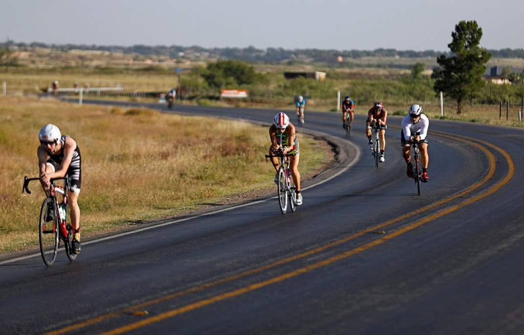 Participants ride their bikes down Vetch Avenue during the Ironman 70.3 Lubbock, Sunday, June 30, 2019, near Slaton, Texas. [Brad Tollefson/A-J Media]