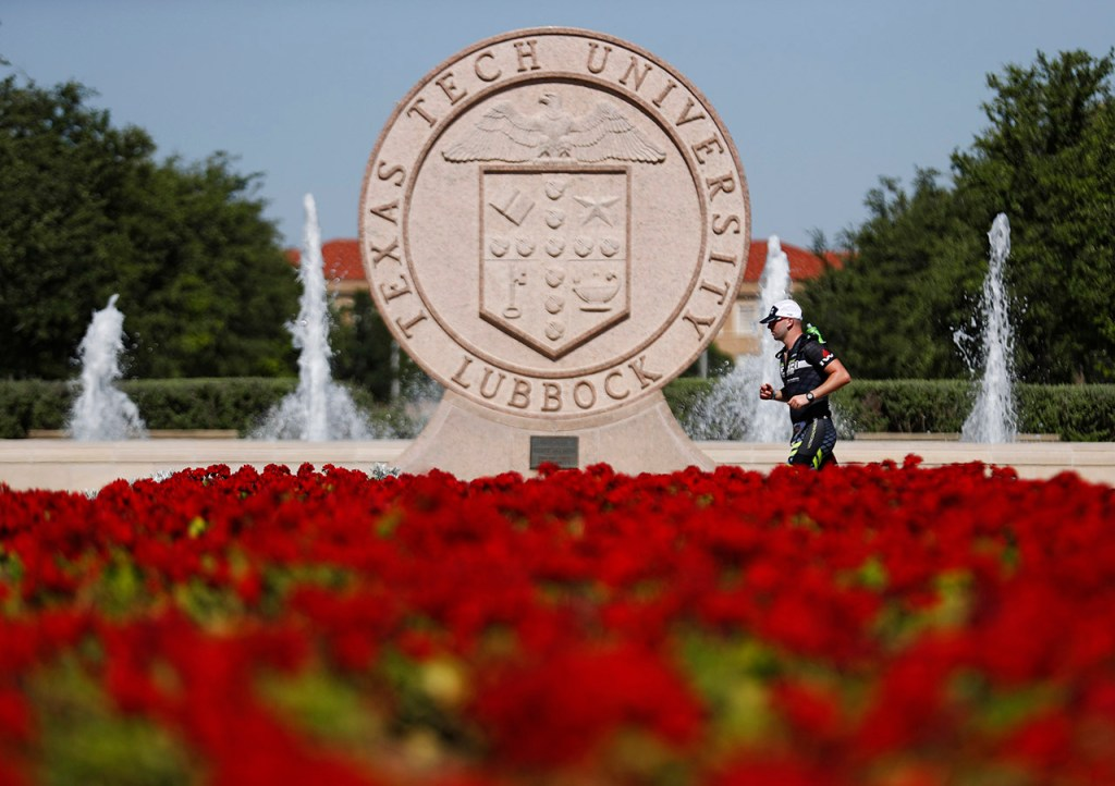 A participant runs past the seal of Texas Tech on campus during the Ironman 70.3 Lubbock, Sunday, June 30, 2019, at Texas Tech in Lubbock, Texas. [Brad Tollefson/A-J Media]