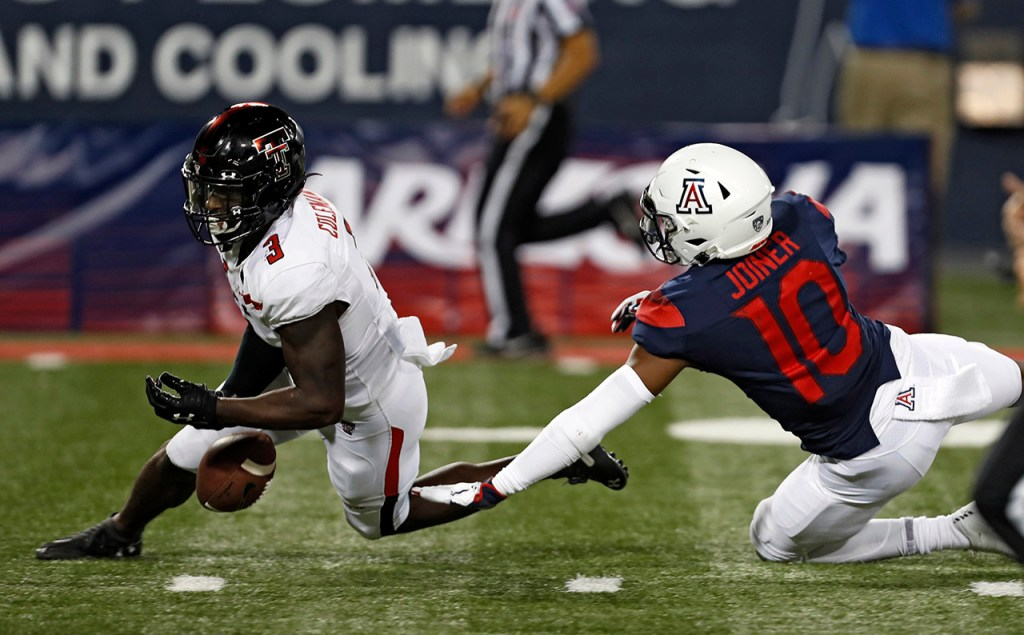 Texas Tech's Douglas Coleman III (3) drops an interception in front of Arizona's Jamarye Joiner (10) during the game Saturday, Sept. 14, 2019, at Arizona Stadium in Tucson, Ariz. [Brad Tollefson/A-J Media]