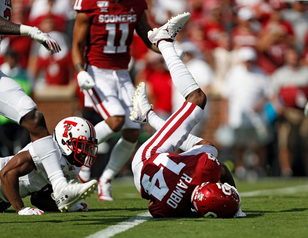 Oklahoma's Charleston Rambo (14) lands on the ground after being tackled during the game against Texas Tech, Saturday, Sept. 28, 2019, at Gaylord Memorial Stadium in Norman, Okla. [Brad Tollefson/A-J Media]