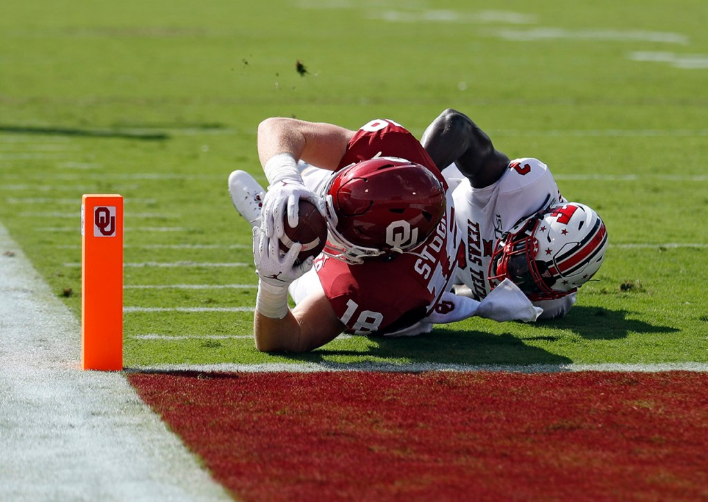 Oklahoma's Austin Stogner (18) lands short of the end zone while tackled by Texas Tech's Douglas Coleman III (3) during the game Saturday, Sept. 28, 2019, at Gaylord Memorial Stadium in Norman, Okla. [Brad Tollefson/A-J Media]