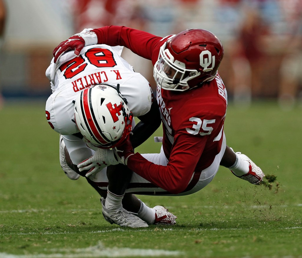 Oklahoma's Nik Bonitto (35) tackles Texas Tech's KeSean Carter (82) during the game Saturday, Sept. 28, 2019, at Gaylord Memorial Stadium in Norman, Okla. [Brad Tollefson/A-J Media]
