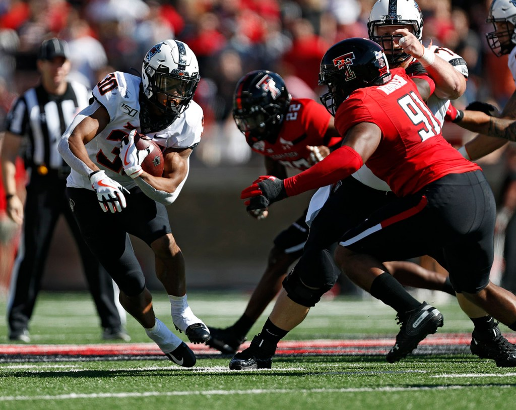 Oklahoma State's Chuba Hubbard (30) runs with the ball during the game against Texas Tech, Saturday, Oct. 5, 2019, in Lubbock, Texas. (AP Photo/Brad Tollefson)