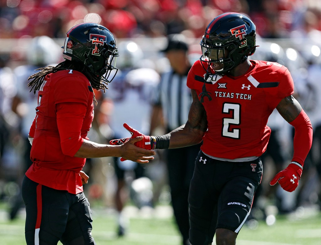 Texas Tech's Jett Duffey (7) high-fives RJ Turner (2) during the game against Oklahoma State, Saturday, Oct. 5, 2019, in Lubbock, Texas. (AP Photo/Brad Tollefson)