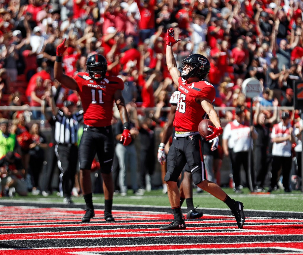 Texas Tech's Dalton Rigdon (86) celebrates after scoring a touchdown during the game against Oklahoma State, Saturday, Oct. 5, 2019, in Lubbock, Texas. (AP Photo/Brad Tollefson)